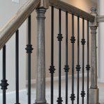Wood and black, decorative metal banister.