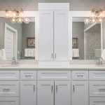 White, double sink bathroom vanity with two mirrors.