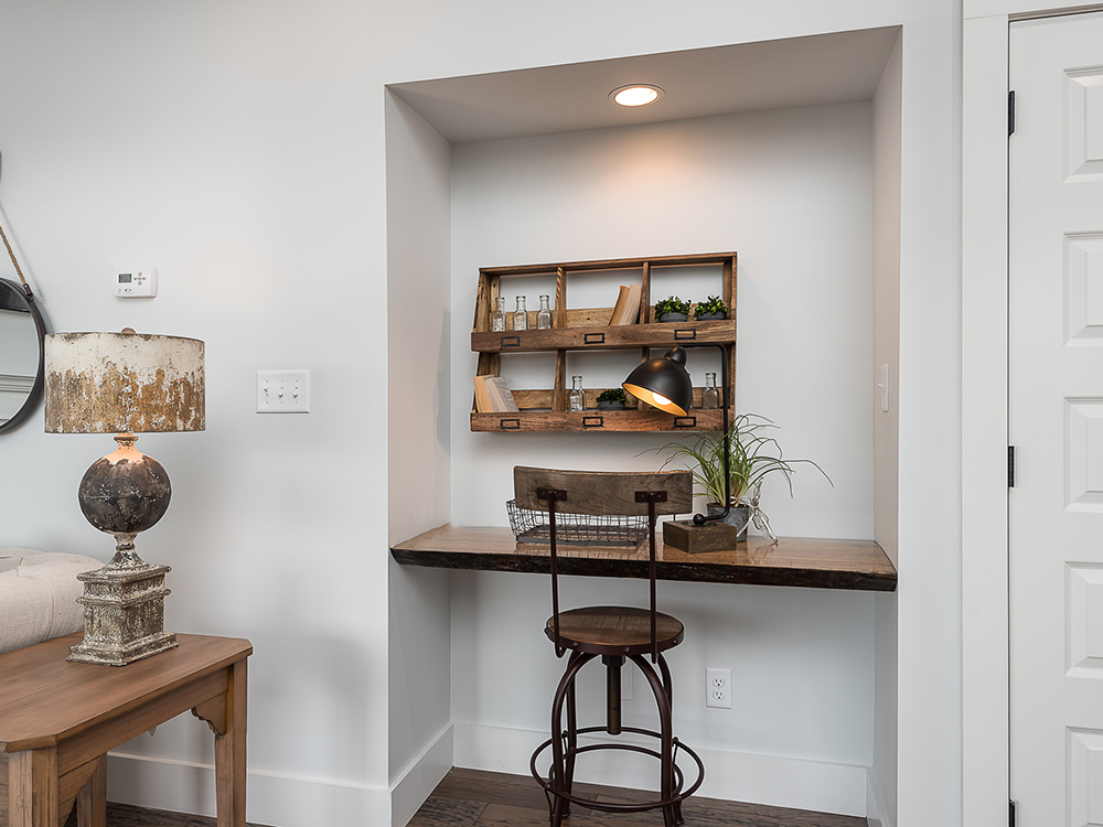 Desk nook with wooden desk and wooden table