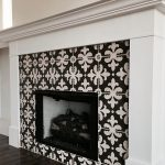 Decorative fireplace with a black and white pattern and white trim.