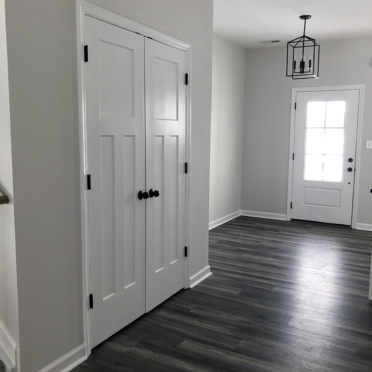 Foyer entrance with white doors