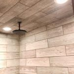 Shower with wooden tile and a rainshower shower head.