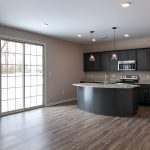 Kitchen with a large sliding glass door constructed by J Perry Homes