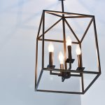 Square ceiling light with 3 candle bulbs.