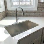 White marble countertops and a corner undermount sink
